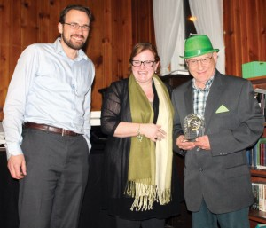 Deputy Mayor Brent Feyter and economic development manager Virginia Wishart presented a 50th anniversary award to Don McLean of Don's Barber Shop.