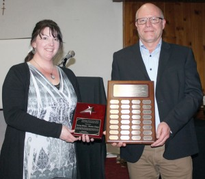 Becky Housenga of Going Green -- EnviroClean accepted the Home-Based Business Award from Theo Vanee.