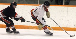 Fort Macleod's Jadon Porterfield carries the puck against Wainwright.