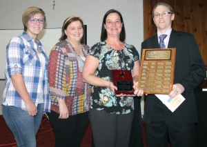 Carissa Paiha, Alissa Wollersheim and Tammy Paiha of Chinook Financial accepted the Outstanding Business Award from Brian Nelson.