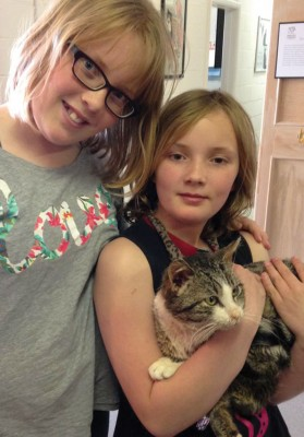 Veronica and Anna Hoskin with their new cat, Gibby, who was brought back to health through the generosity of Fort Macleod residents.