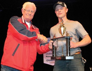 Al Douglas presents the  Clint Jordan Memorial Award to Hunter Curran at the Fort Macleod Minor Hockey awards night.