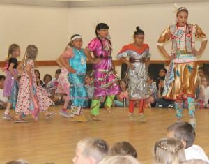 Sandra LaMouche leads the W.A. Day school dancers.