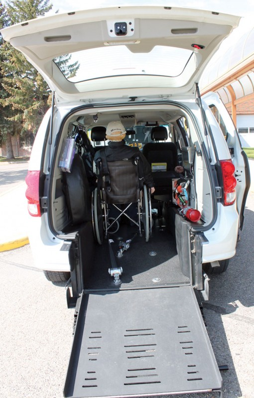 A ramp folds down to allow a wheelchair to be put inside the van.