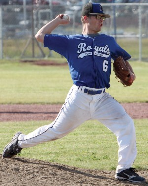 Aidan Kidd pitching for the Royals in their win over Tri County Cardinals.