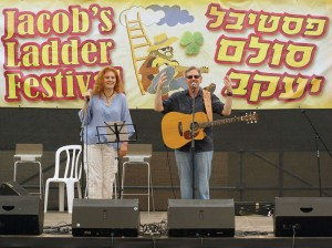 Tim Isberg and his spouse Oxana on stage at Jacob's Ladder, a major folk festival in Israel.