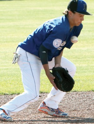 Ty Odney of the Royals uses his body to block a bouncing grounder.