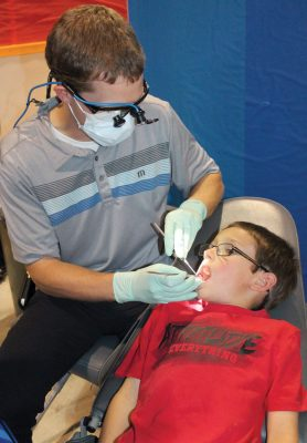 Dr. Brett Holt was on hand to give free dental exams.