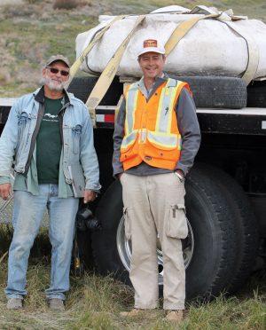 Archeologist Bob Dawe of the Royal Alberta Museum and Darren Tanke, a senior technician with the Royal Tyrell Museum with the roasting pit.