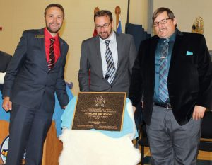 Calgary Shaw MLA Graham Sucha, Fort Macleod Deputy Mayor Brent Feyter and Livingstone Range School Board chairman Brad Toone unveil the plaque Thursday at the grand opening of F.P. Walshe school.