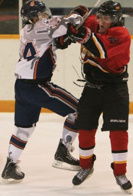 Jeremy Weasel Moccasin of the Kainai Braves collides with Ashton Zintel of the Fort Macleod Mustangs.