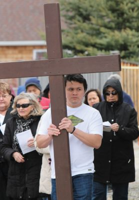 Fort Macleod Christians staged a symbolic walk Good Friday in the footsteps of their saviour. Close to 50 people took part in the annual Way of the Cross procession.