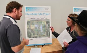 Jason Pigeon of Scott Land and Lease answers quesetions from area residents on the proposed solar farm to be constructed east of Claresholm.