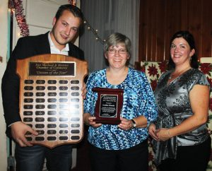 Marco Van Huigenbos and Chamber president Becky Housenga presented the 2017 Citizen of the Year Award to Cathie Harris.