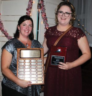 Chamber president Becky Housenga presented the Outstanding Business Award to Merel Crosse of Bloem Floral Designs.