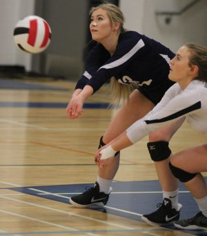 Janelle Stockton and Tiegan Trotter of the Flyers defend in the postseason tournament.