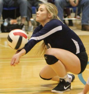 Janelle Stockton of the Flyers digs a ball in the bronze medal playoff.