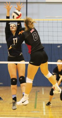 Stephanie Tobler of the Flyers defends at the net against Raymond Comets.