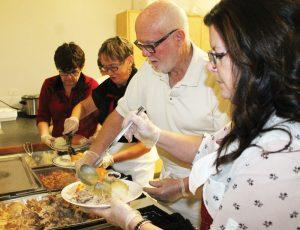 Linda Hann, Dianna Wakelin, Phil Wakelin and Leslie-Anne Hornberger filled plates of food.